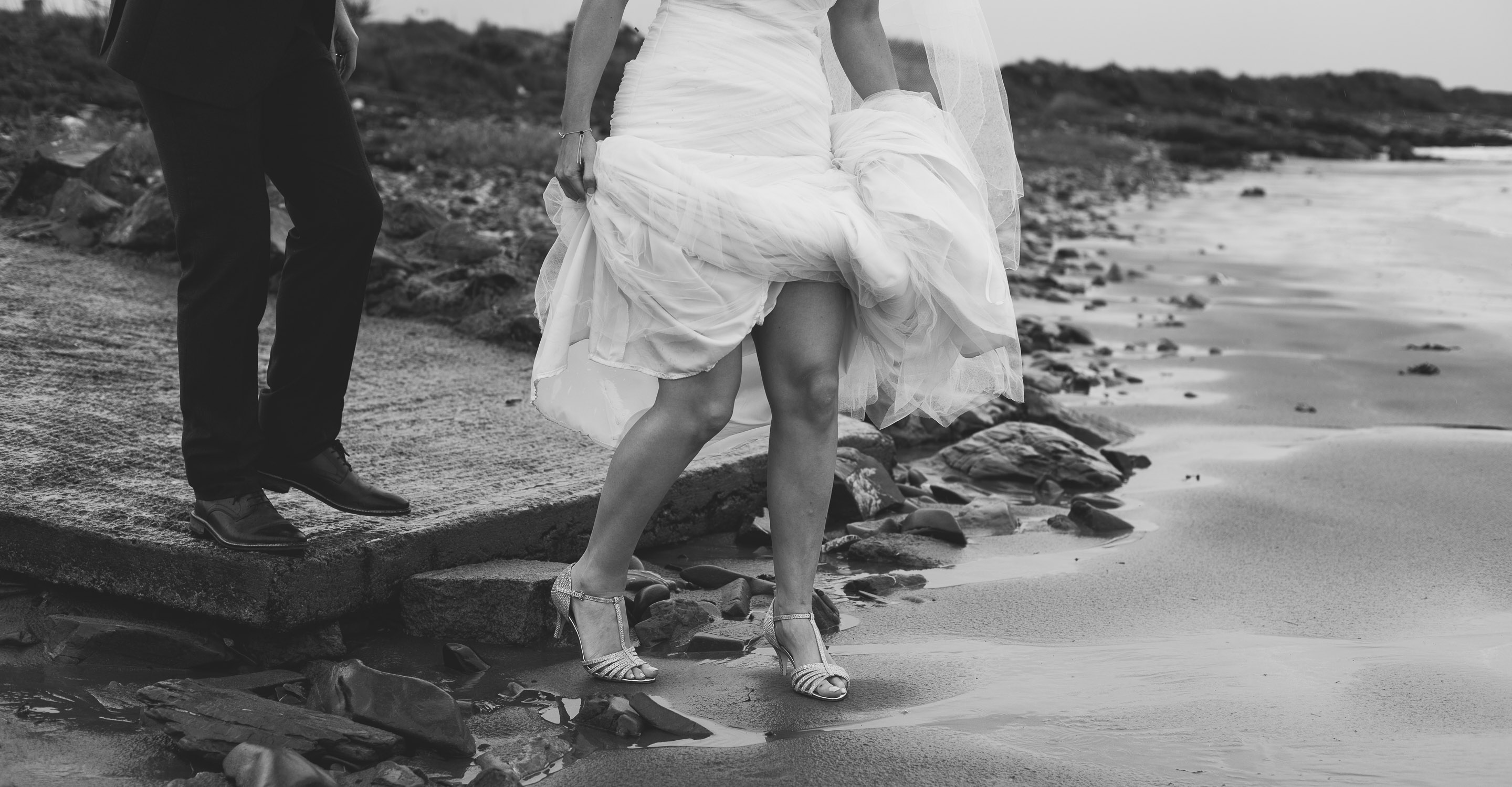 Bride and groom walk on Tyrella beach after wedding ceremony at the mill at ballyduggan