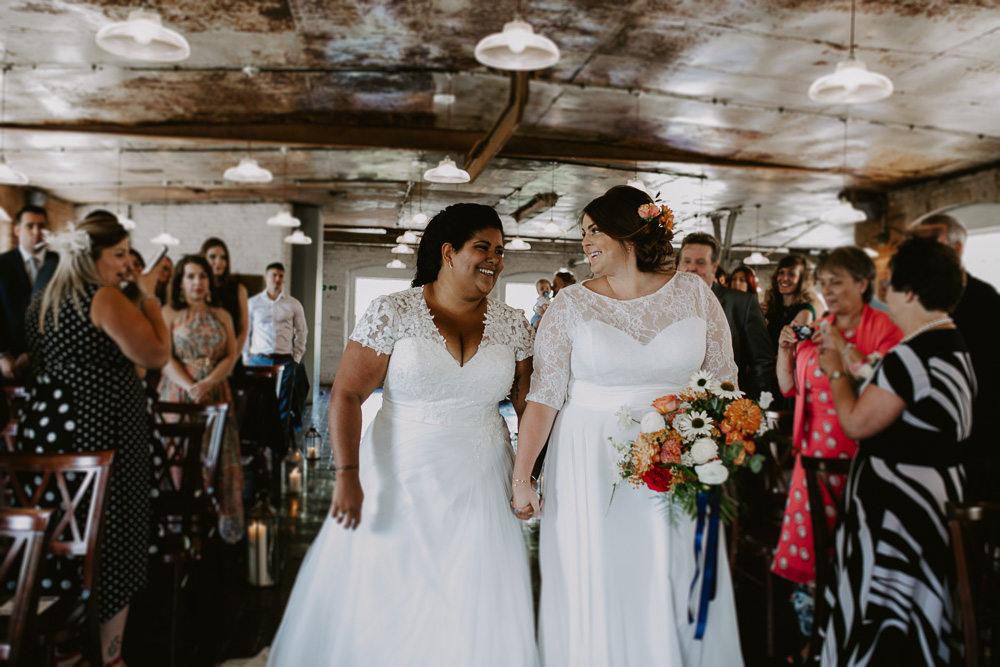 Both brides walk down aisle together