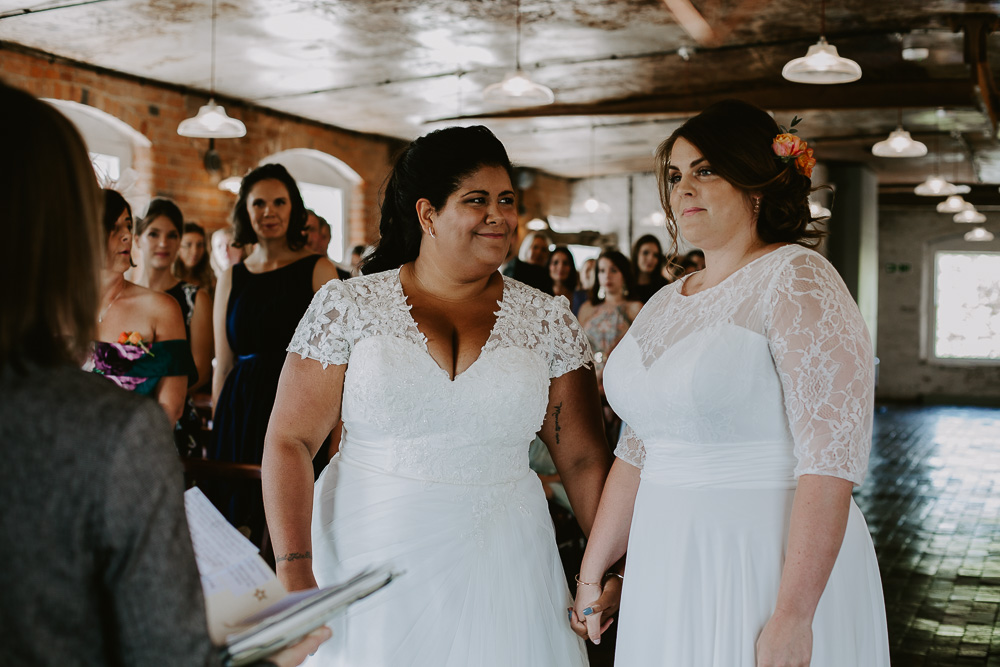 Two brides during wedding ceremony at West Mill in Derby
