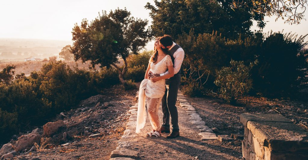Bride and groom in ancient ruins in Cyprus