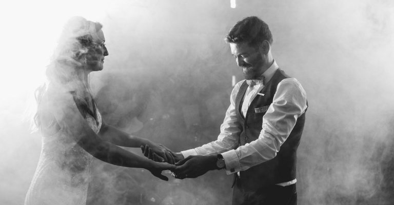 first dance, smoke, bride and groom holding hands