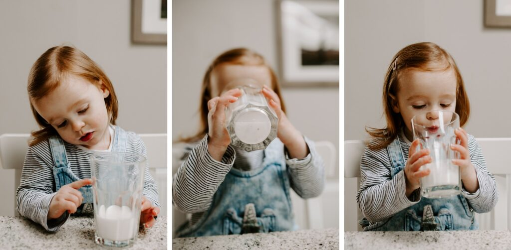 Little girl drinks milk and makes funny face, family portraits