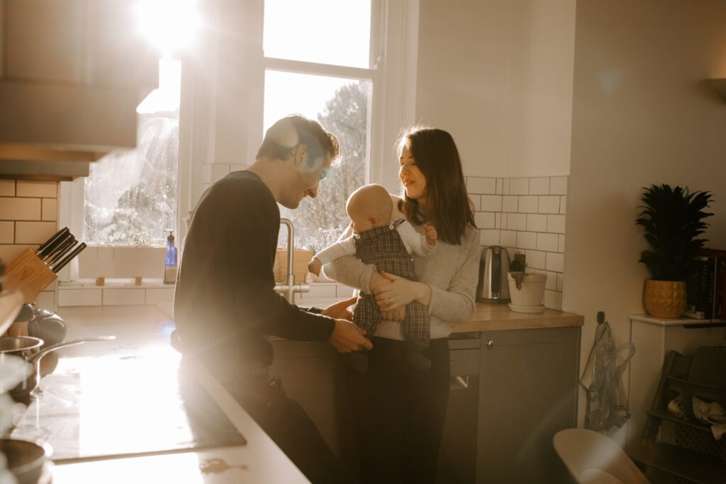 family portraits in family kitchen, mum dad and baby