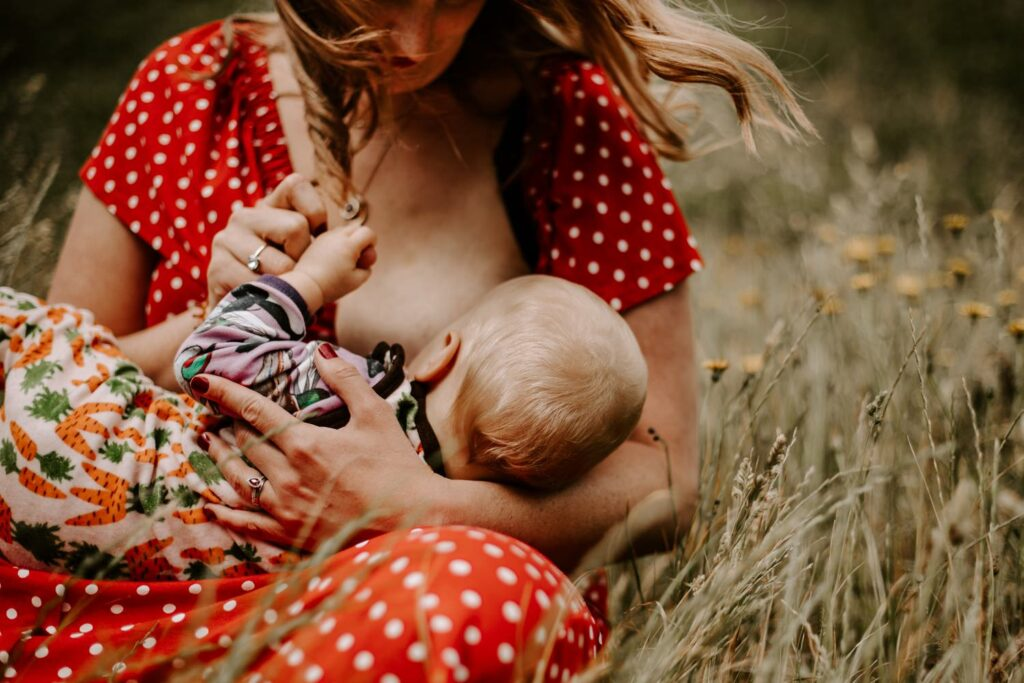 closeup portrait of mother breastfeeding baby, newborn session
