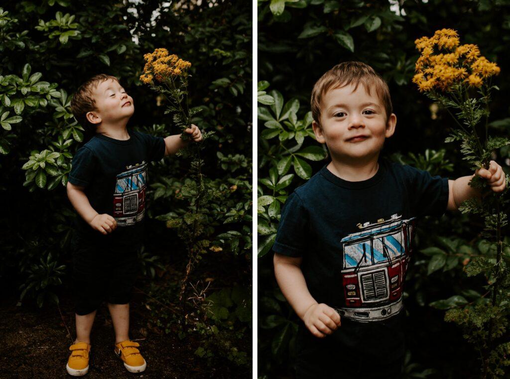 little boy in garden smells yellow flowers, family photoshoot