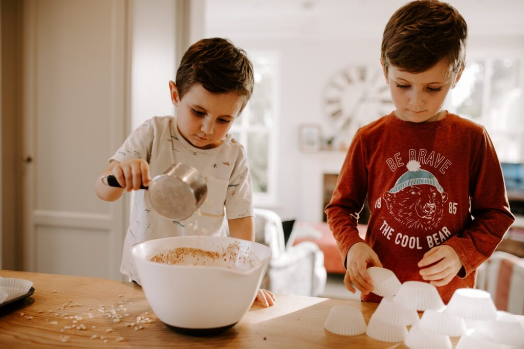 young brothers make buns during family photo session