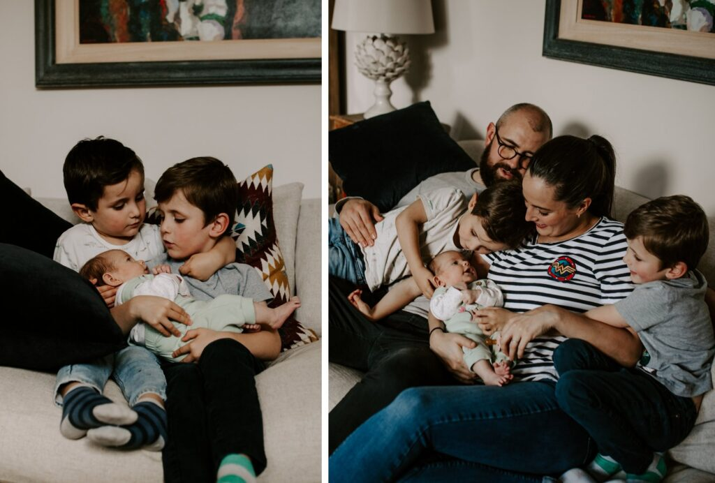 young brothers hold newborn sister, family portraits