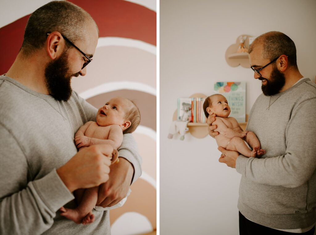 father and newborn daughter looking at each other