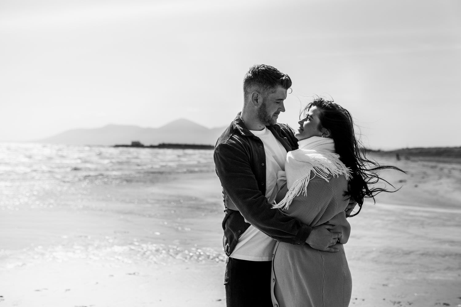 Couple engagement at the beach, Northern Ireland, Mourne Mountains in background